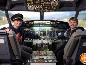 Children in cockpit looking happy